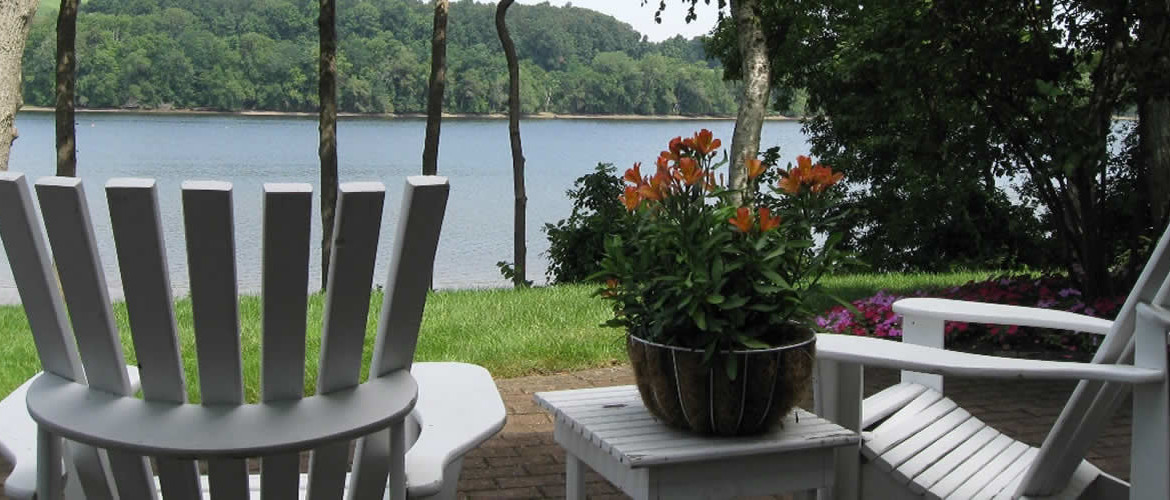 White Lawn chairs along waters edge